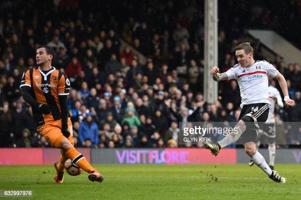 Fulham's Norwegian midfielder Stefan Johansen scores their fourth goal during the English FA Cup fourth round football match between Fulham and Hull...