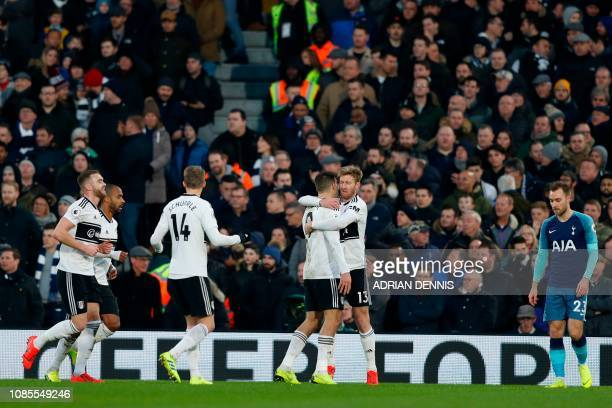 Fulham's players celebrate after an own goal from Tottenham Hotspur's Spanish striker Fernando Llorente gives them the lead during the English...