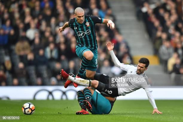 Fulham's Portuguese striker Rui Fonte is tackled by Southampton's Spanish midfielder Oriol Romeu and Southampton's English defender Ryan Bertrand...