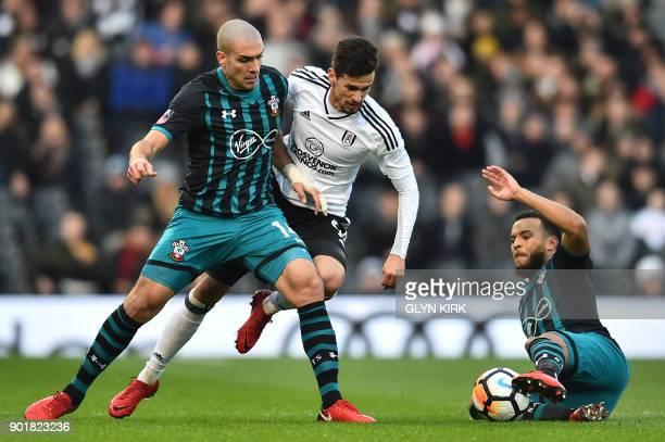 Fulham's Portuguese striker Rui Fonte vies with Southampton's Spanish midfielder Oriol Romeu and Southampton's English defender Ryan Bertrand during...