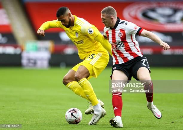 Fulham's Ruben LoftusCheek holds off the challenge from Sheffield United's John Lundstram during the Premier League match between Sheffield United...