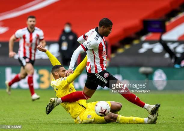 Fulham's Ruben LoftusCheek tackles Sheffield United's Rhian Brewster during the Premier League match between Sheffield United and Fulham at Bramall...