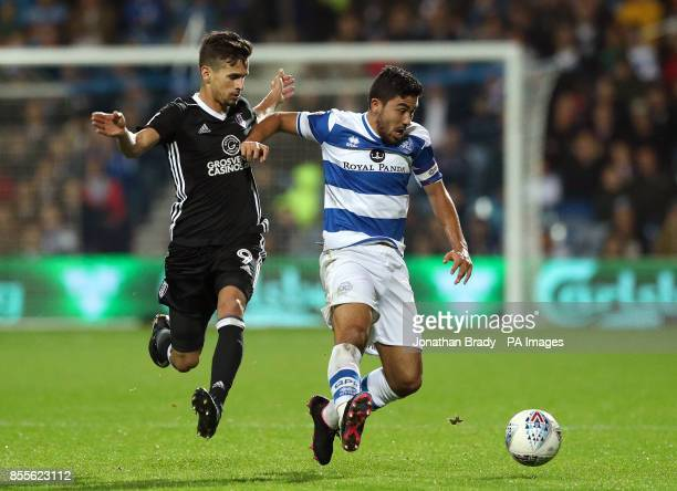 Fulham's Rui Fonte and Queens Park Rangers' Massimo Luongo in action during the Sky Bet Championship match at Loftus Road London