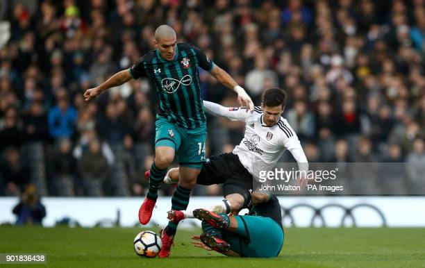 Fulham's Rui Fonte battles for possession of the ball with Southampton's Oriol Romeu during the FA Cup third round match at Craven Cottage London
