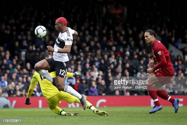 Fulham's Ryan Babel capitalises on a mistake by Liverpool goalkeeper Alisson Becker and Virgil van Dijk to score his side's first goal of the game...