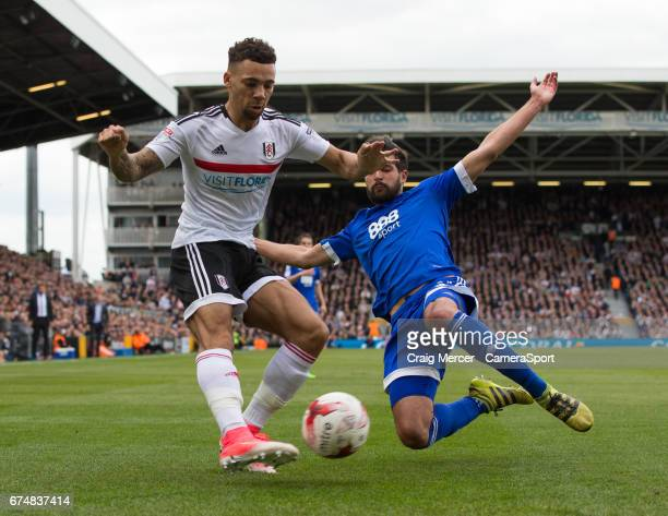 Fulham's Ryan Fredericks gets a cross in under pressure from Brentford's Yoann Barbet during the Sky Bet Championship match between Fulham and...