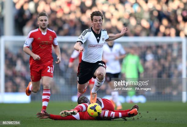 Fulham's Scott Parker and Southampton's Victor Wanyama battle for possession of the ball during the Barclays Premier League match at Craven Cottage...