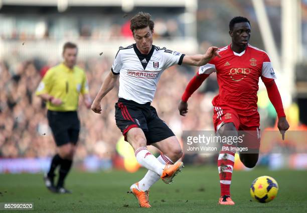 Fulham's Scott Parker gets a shot off on goal under pressure from Southampton's Victor Wanyama