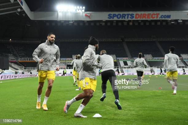 Fulham's Serbian striker Aleksandar Mitrovic and teammates warm up ahead of the English Premier League football match between Newcastle United and...