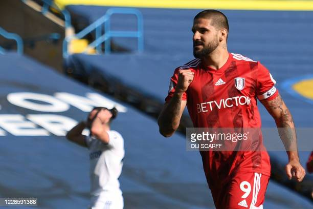 Fulham's Serbian striker Aleksandar Mitrovic celebrates after scoring from the penalty spot during the English Premier League football match between...