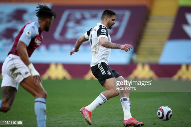 Fulham's Serbian striker Aleksandar Mitrovic celebrates on his way to scoring the opening goal after a mistake from Aston Villa's English defender...
