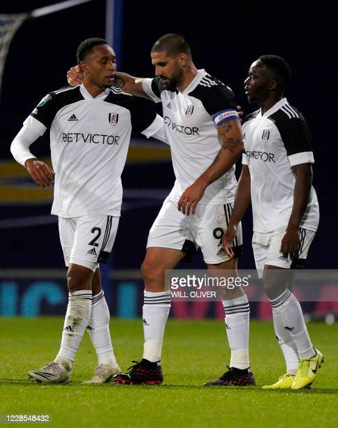 Fulham's Serbian striker Aleksandar Mitrovic celebrates scoring the opening goal during the English League Cup second round football match between...