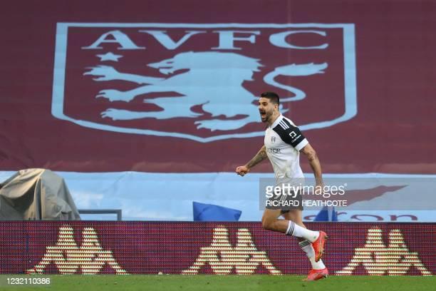 Fulham's Serbian striker Aleksandar Mitrovic celebrates scoring the opening goal during the English Premier League football match between Aston Villa...