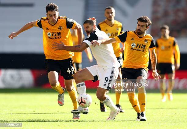 Fulham's Serbian striker Aleksandar Mitrovic comes under pressure during the English Premier League football match between Wolverhampton Wanderers...