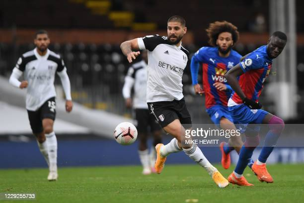 Fulham's Serbian striker Aleksandar Mitrovic controls the ball during the English Premier League football match between Fulham and Crystal Palace at...