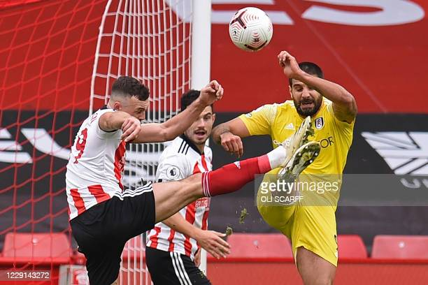 Fulham's Serbian striker Aleksandar Mitrovic fouls Sheffield United's English defender Jack Robinson for a penalty to Sheffield during the English...