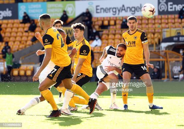Fulham's Serbian striker Aleksandar Mitrovic has a shot during the English Premier League football match between Wolverhampton Wanderers and Fulham...