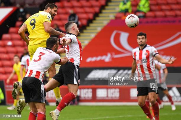 Fulham's Serbian striker Aleksandar Mitrovic has an unsuccessful header during the English Premier League football match between Sheffield United and...