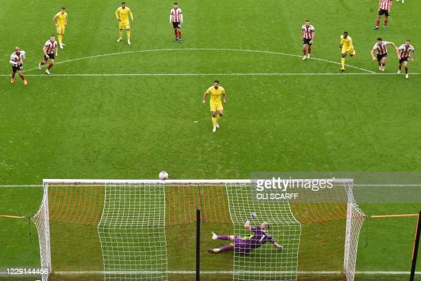 Fulham's Serbian striker Aleksandar Mitrovic hits this penalty over the bar during the English Premier League football match between Sheffield United...