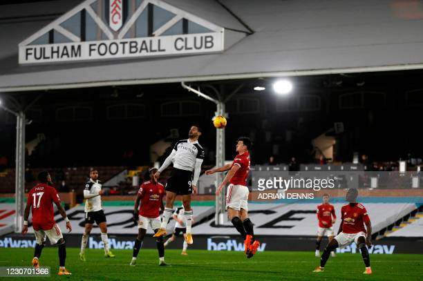 Fulham's Serbian striker Aleksandar Mitrovic jumps against Manchester United's English defender Harry Maguire for a header during the English Premier...