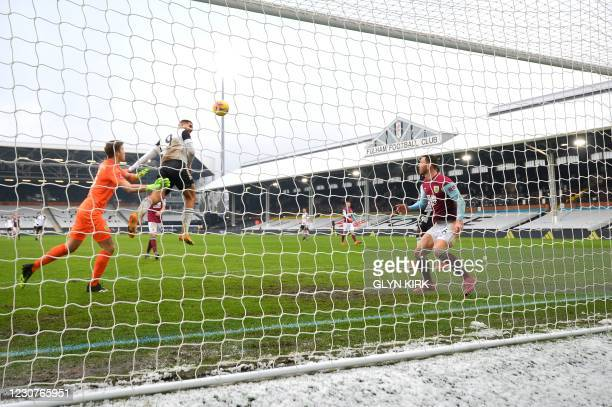 Fulham's Serbian striker Aleksandar Mitrovic jumps to head the ball and score but the goal was ruled out for offside during the English FA Cup fourth...