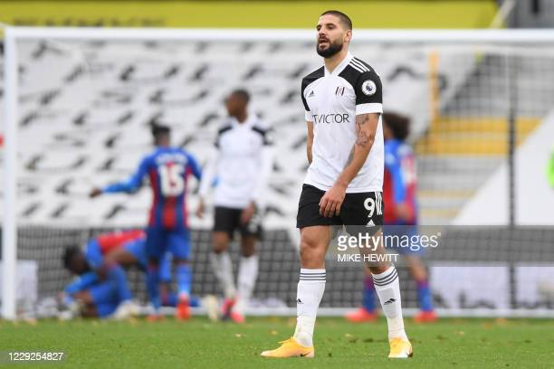 Fulham's Serbian striker Aleksandar Mitrovic reacts after Crystal Palace's Ivorian striker Wilfried Zaha scores his team's second goal during the...