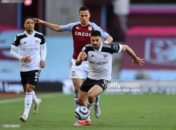 Fulham's Serbian striker Aleksandar Mitrovic runs away from Aston Villa's Dutch striker Anwar El Ghazi during the English Premier League football...