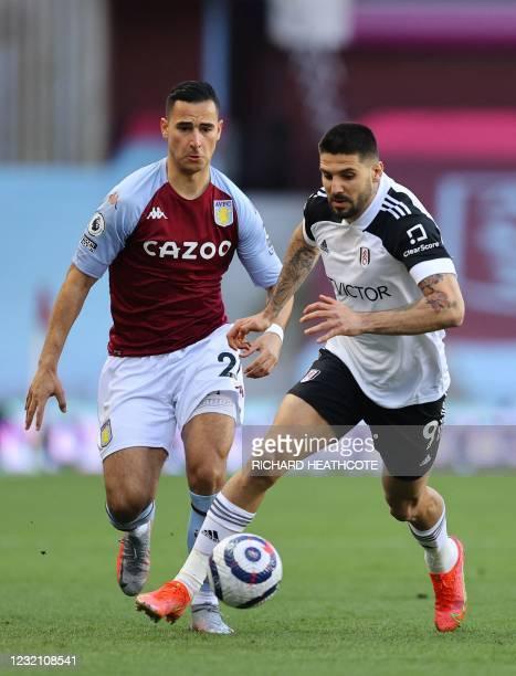 Fulham's Serbian striker Aleksandar Mitrovic runs with the ball as Aston Villa's Dutch striker Anwar El Ghazi chases after him during the English...