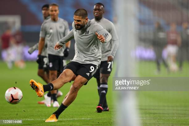 Fulham's Serbian striker Aleksandar Mitrovic shoots at goal during the warm up ahead of the English Premier League football match between West Ham...