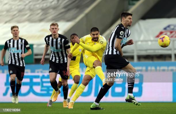 Fulham's Serbian striker Aleksandar Mitrovic shoots but fails to score during the English Premier League football match between Newcastle United and...
