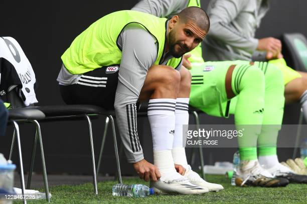 Fulham's Serbian striker Aleksandar Mitrovic sits on the bench during the English Premier League football match between Fulham and Arsenal at Craven...