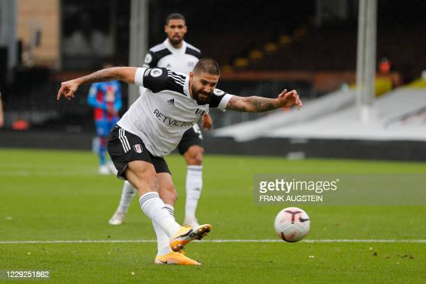 Fulham's Serbian striker Aleksandar Mitrovic takes a shot at goal during the English Premier League football match between Fulham and Crystal Palace...