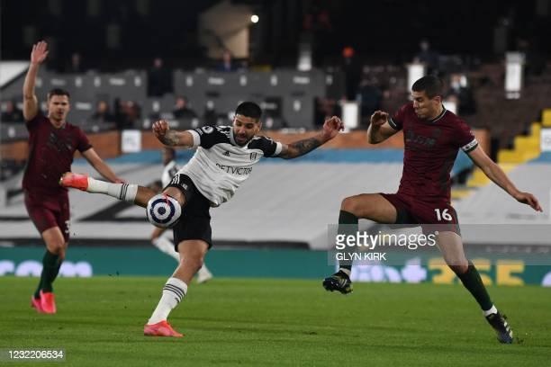 Fulham's Serbian striker Aleksandar Mitrovic takes a shot during the English Premier League football match between Fulham and Wolverhampton Wanderers...