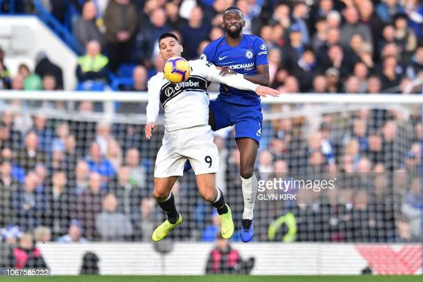 Fulham's Serbian striker Aleksandar Mitrovic vies with Chelsea's German defender Antonio Rudiger during the English Premier League football match...