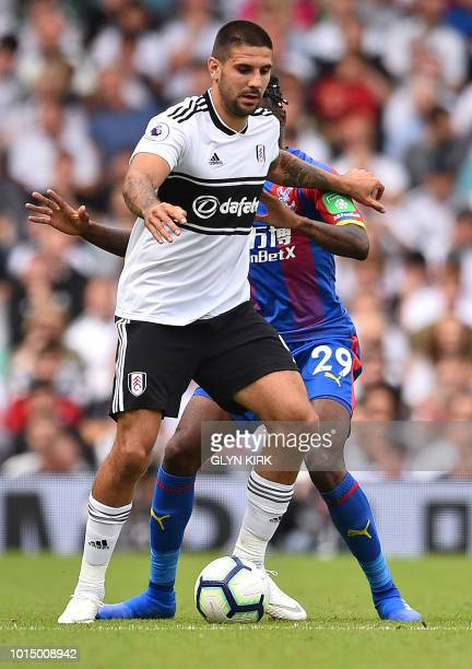 Fulham's Serbian striker Aleksandar Mitrovic vies with Crystal Palace's English midfielder Aaron WanBissaka during the English Premier League...