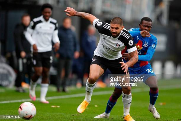 Fulham's Serbian striker Aleksandar Mitrovic vies with Crystal Palace's English defender Tyrick Mitchell during the English Premier League football...