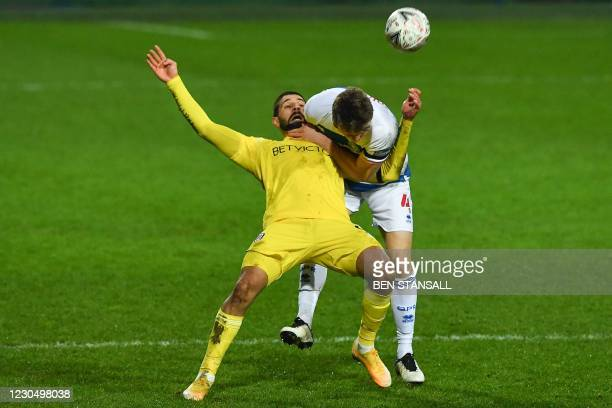 Fulham's Serbian striker Aleksandar Mitrovic vies with Fulham's Belgian defender Denis Odoi during the English FA Cup third round football match...