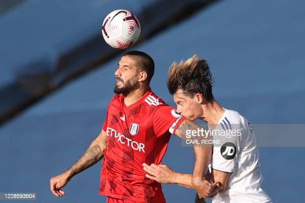 Fulham's Serbian striker Aleksandar Mitrovic vies with Leeds United's German defender Robin Koch during the English Premier League football match...