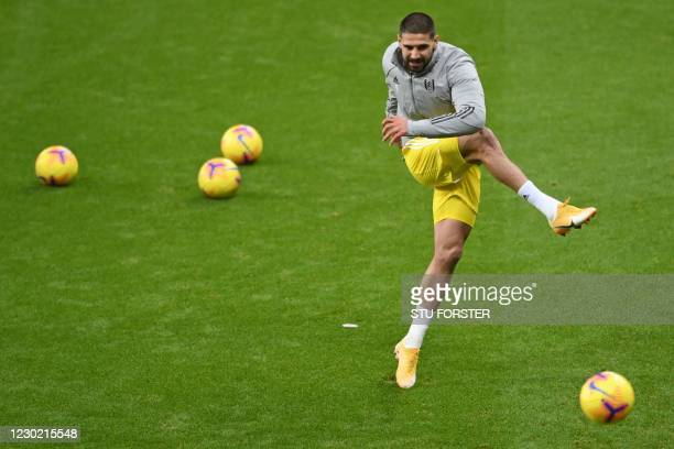 Fulham's Serbian striker Aleksandar Mitrovic warms up ahead of the English Premier League football match between Newcastle United and Fulham at St...