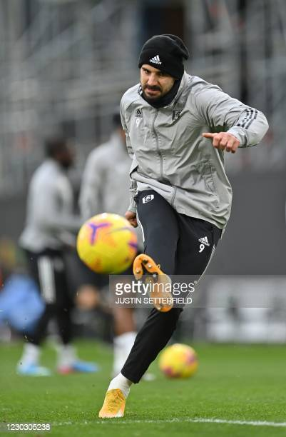 Fulham's Serbian striker Aleksandar Mitrovic warms up ahead of the English Premier League football match between Fulham and Southampton at Craven...