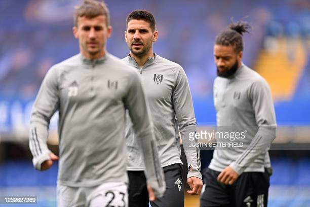 Fulham's Serbian striker Aleksandar Mitrovic warms up ahead of the English Premier League football match between Chelsea and Fulham at Stamford...