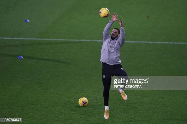Fulham's Serbian striker Aleksandar Mitrovic warms up during the English Premier League football match between Fulham and Manchester United at Craven...