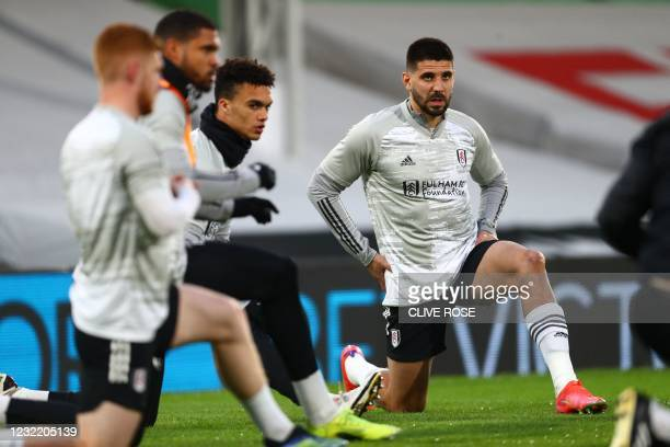 Fulham's Serbian striker Aleksandar Mitrovic warms up with teammates ahead of the English Premier League football match between Fulham and...