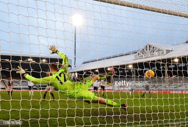 Fulham's Slovakian goalkeeper Marek Rodak dives the wrong way as Burnley's English striker Jay Rodriguez scores from the penalty spot for their...