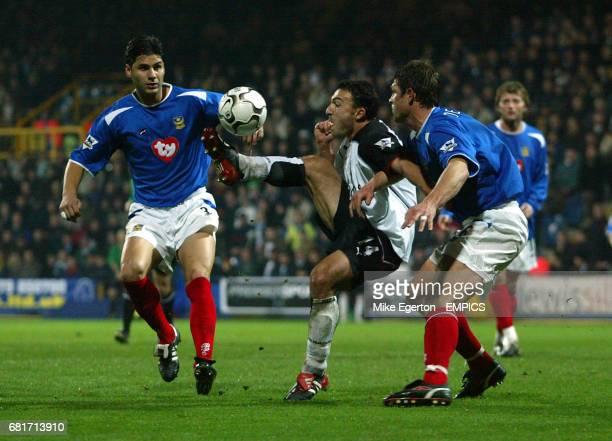 Fulham's Steed Malbranque gets in between Portsmouth's Dejan Stefanovic and Arjan De Zeeuw