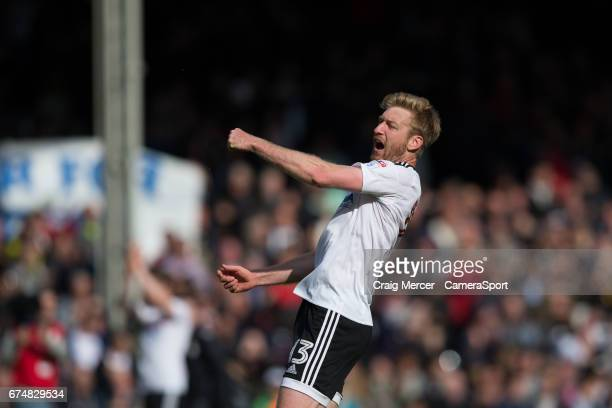 Fulham's Tim Ream celebrates at full time of the Sky Bet Championship match between Fulham and Brentford at Craven Cottage on April 29 2017 in London...