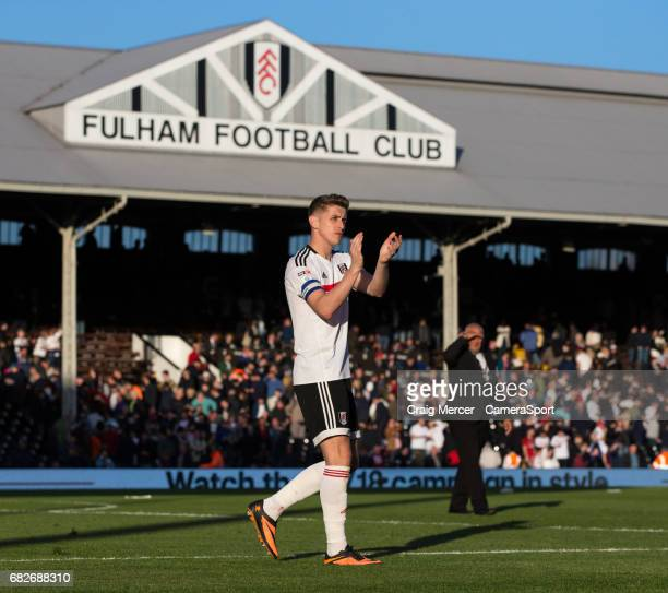 Fulham's Tom Cairney applauds the fans after the Sky Bet Championship match between Fulham and Reading at Craven Cottage on May 13 2017 in London...