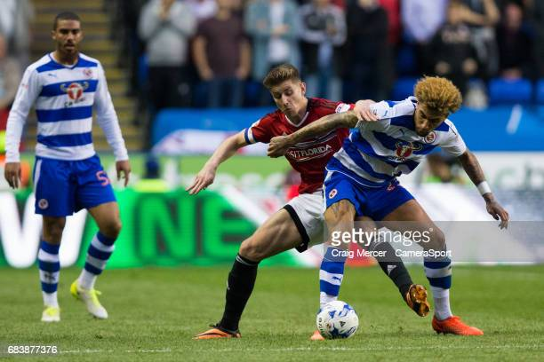 Fulham's Tom Cairney battles for possession with Reading's Daniel Williams during the Sky Bet Championship PlayOff Semi Final Second Leg match...
