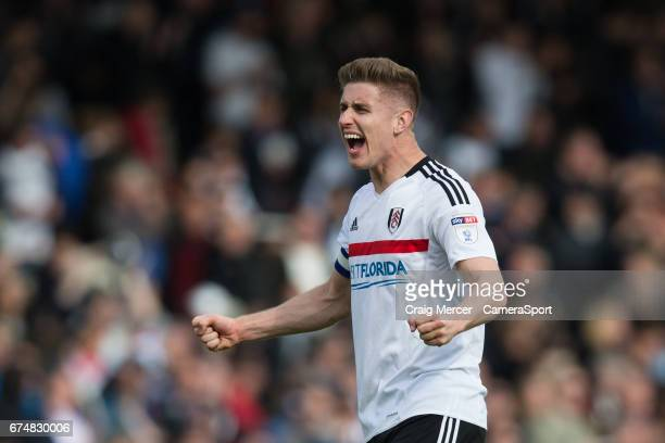 Fulham's Tom Cairney celebrates at full time of the Sky Bet Championship match between Fulham and Brentford at Craven Cottage on April 29 2017 in...