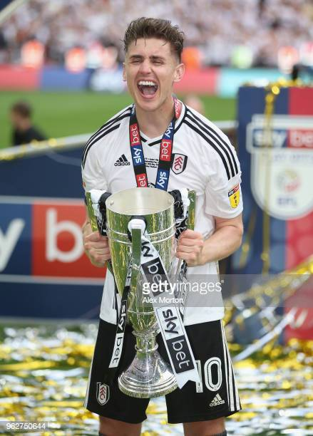 Fulham's Tom Cairney celebrates with the Championship Play Off Final trophy during the Sky Bet Championship Play Off Final match between Aston Villa...